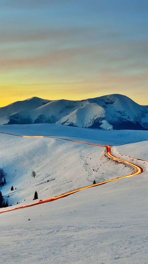 Mountain Flamingo Landscape Scenics Nature Outdoors Snow Tranquility Mountain Range Lake Sand Beauty In Nature Sunset Cold Temperature Day Sky Colony Winter No People Bird