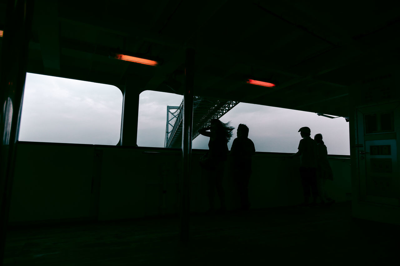 Low angle view of silhouette people at observation point by onaruto bridge