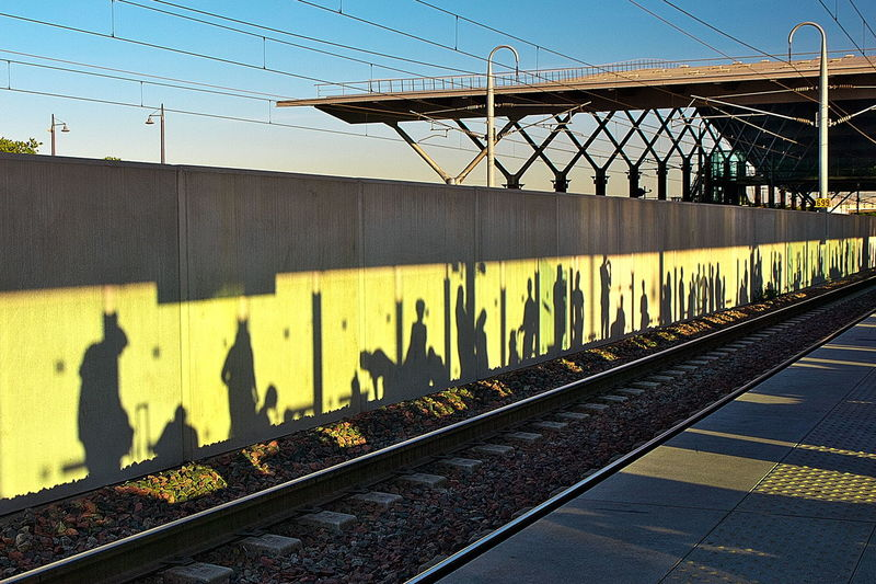 Shadow of railroad station against clear sky