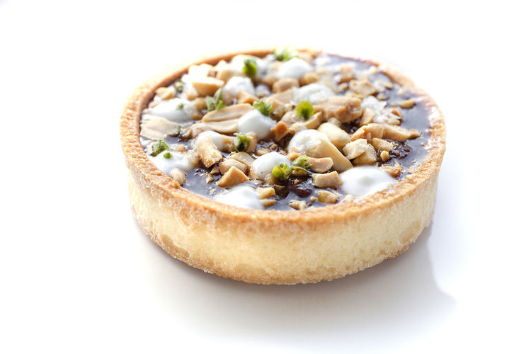 Gourmet caramel peanut tart on white background. Dessert Fine Dining Food Food And Drink Gourmet Horizontal No People Pastry Peanuts Ready-to-eat Tart White Background