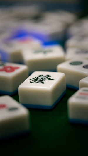Fortune Gambling Luck Mahjong 麻將 Arts Culture And Entertainment Betting Choice Close-up Day Focus On Foreground Food Food And Drink Fortune Group Of Objects In A Row Indoors  Large Group Of Objects Leisure Activity Luck Mahjong Mahjong Tiles No People Relaxation Selective Focus Text White Color