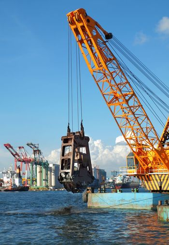 Dredging operation in Kaohsiung Port in Taiwan Dredging Crane Kaohsiung Blue Sky Commercial Dock Crane - Construction Machinery Dredging Equipment Drilling Rig Harbor Industry Ocean Bay Ocean Water Port Shipping  Steel Cables Transportation