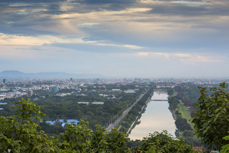 A view over the city of Mandalay from Mandalay Hill temple Architecture City Cloud - Sky Built Structure Building Exterior Cityscape Travel Destinations Residential District High Angle View Sunset_collection Sunset Mandalay Myanmar ASIA Blue Blue Sky Outdoors Water Day Burma Asian Travel