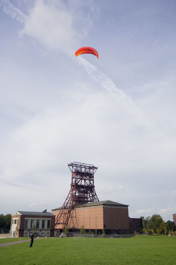 man with a power kite - action in an old industrial area with a shaft tower Architecture Flying Flying High Fun Gelsenkirchen Germany Grass Industrial Industrial Building  Industrial Culture Industriekultur Kite Kite Flying Kiting Low Angle View NRW One Man Only One Person People Power Kite Powerkite Ruhrgebiet Shaft Tower Sport Strukturwandel