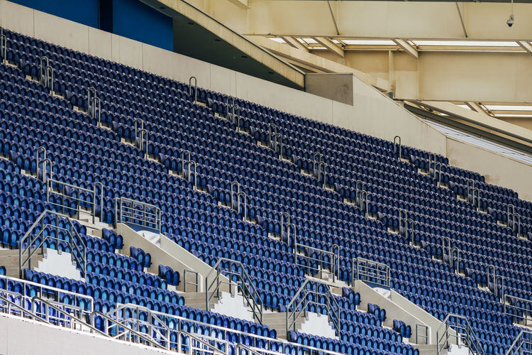 No People In A Row Seat Architecture Technology Large Group Of Objects Stadium Repetition Metal Sport Indoors  Empty Blue Abundance High Angle View Industrial Equipment Factory Built Structure Absence Order Silver Colored