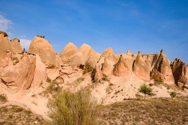 Panoramic view of rocks against sky