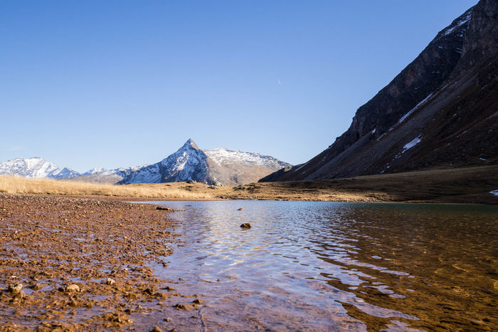 Autum in Bad Sportgastein – stunning view at the lake in the mountains. Alpine Austria Autumn Little Tibet National Park Alps Autumcolors Beauty In Nature Clear Sky Gastein Lake Landscape Mountain Mountain Range Mountainlake No People Outdoors Scenics Tranquility