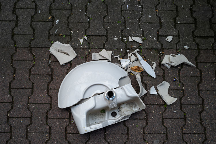 Broken Sink No People High Angle View Footpath Day Street White Color Transportation Broken City Outdoors Sidewalk Metal Nature Abandoned Obsolete Misfortune Directly Above Teapot Damaged White Sink