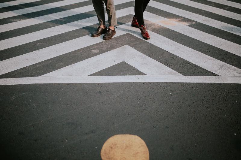 Low section of men on zebra crossing