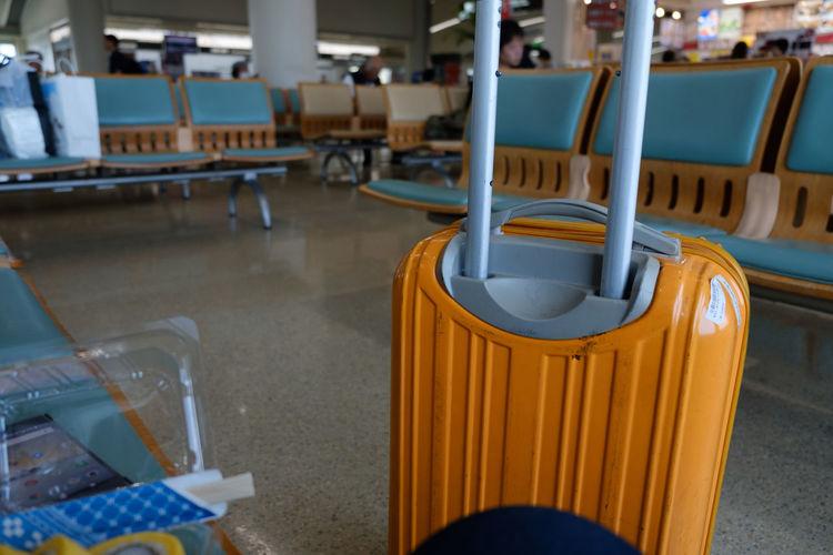 Close-up of wheeled luggage at airport
