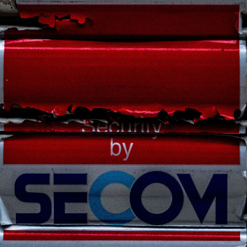 A Broken Security City Close-up No People OSAKA Red Rupture Seal Secom Security Shutter Sticker Streetphotography Tear Trademark Urban