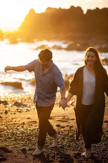 Two People Togetherness Emotion Women Positive Emotion Leisure Activity Land Bonding Nature Adult Couple - Relationship Beach Lifestyles Front View Real People Heterosexual Couple Happiness Casual Clothing Men Love