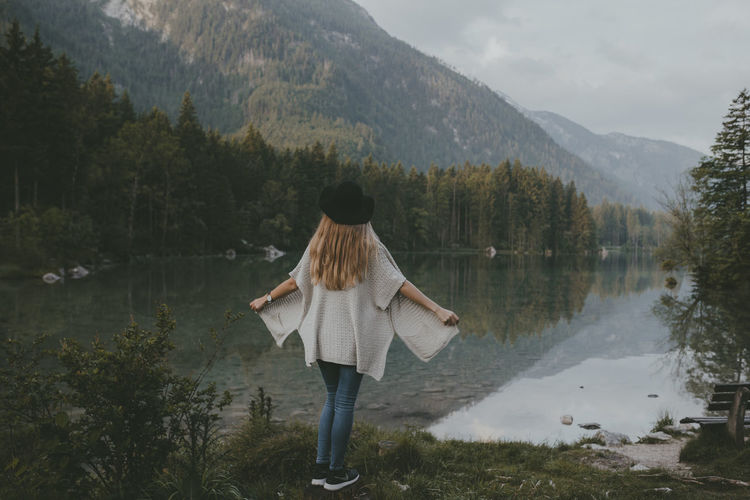 Beauty In Nature Casual Clothing Day Full Length Idyllic Lake Lakeshore Landscape Leisure Activity Lifestyles Mountain Mountain Range Nature Non-urban Scene Outdoors Remote Scenics Sky Tourism Tranquil Scene Tranquility Tree Vacations Water