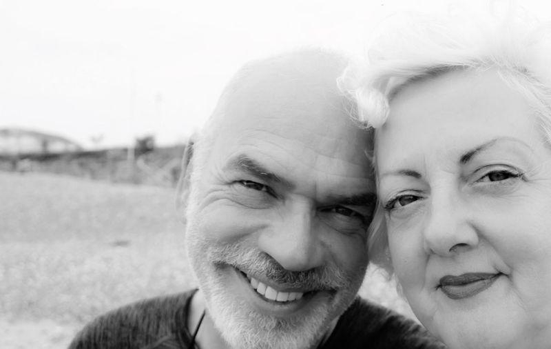 Close-up portrait of smiling mature couple