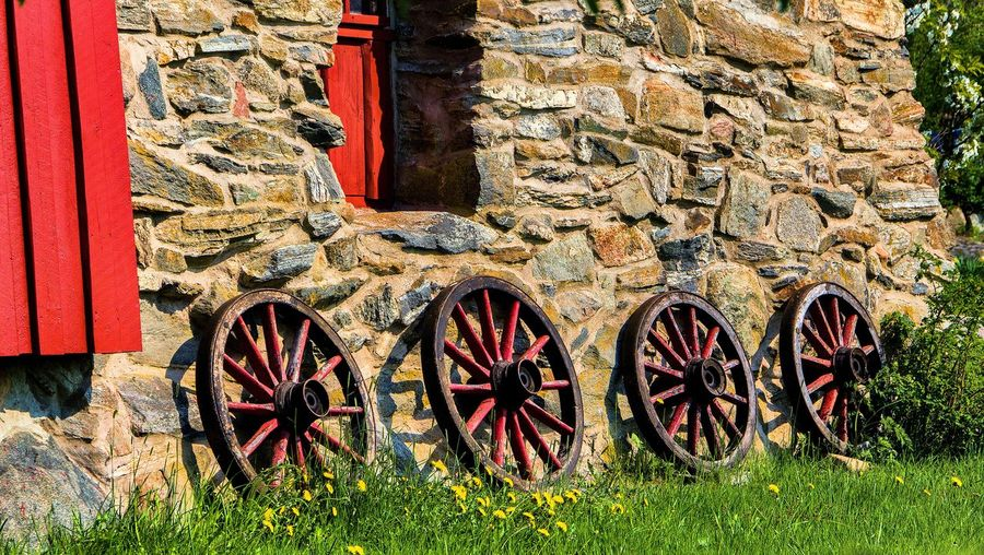 Wagon Wheels Against Wall