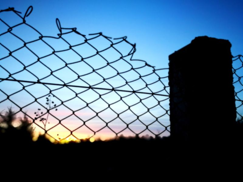 Awesome sunset in Estonia Security Prison Barbed Wire Fence Protection Law Sky Safety Razor Wire Chainlink Fence Metal No People Trapped War Clear Sky Outdoors Sunset Day Military Legal Trial