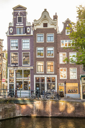 Amsterdam Netherlands Architecture Building Building Exterior Built Structure Canal Canal Houses City Day Dutch Architecture Dutch Houses Façade Holland House Mode Of Transportation Nature No People Outdoors Residential District Sky Street Tourism Transportation Tree Water Window