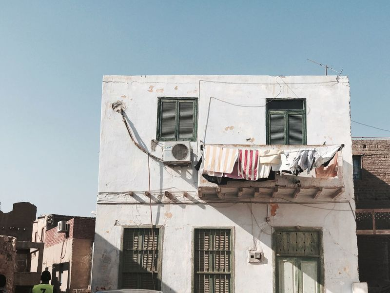 EyeEm Selects Architecture Building Exterior Built Structure Low Angle View Window No People Outdoors Laundry Day Abandoned Residential Building Drying Clear Sky Sky