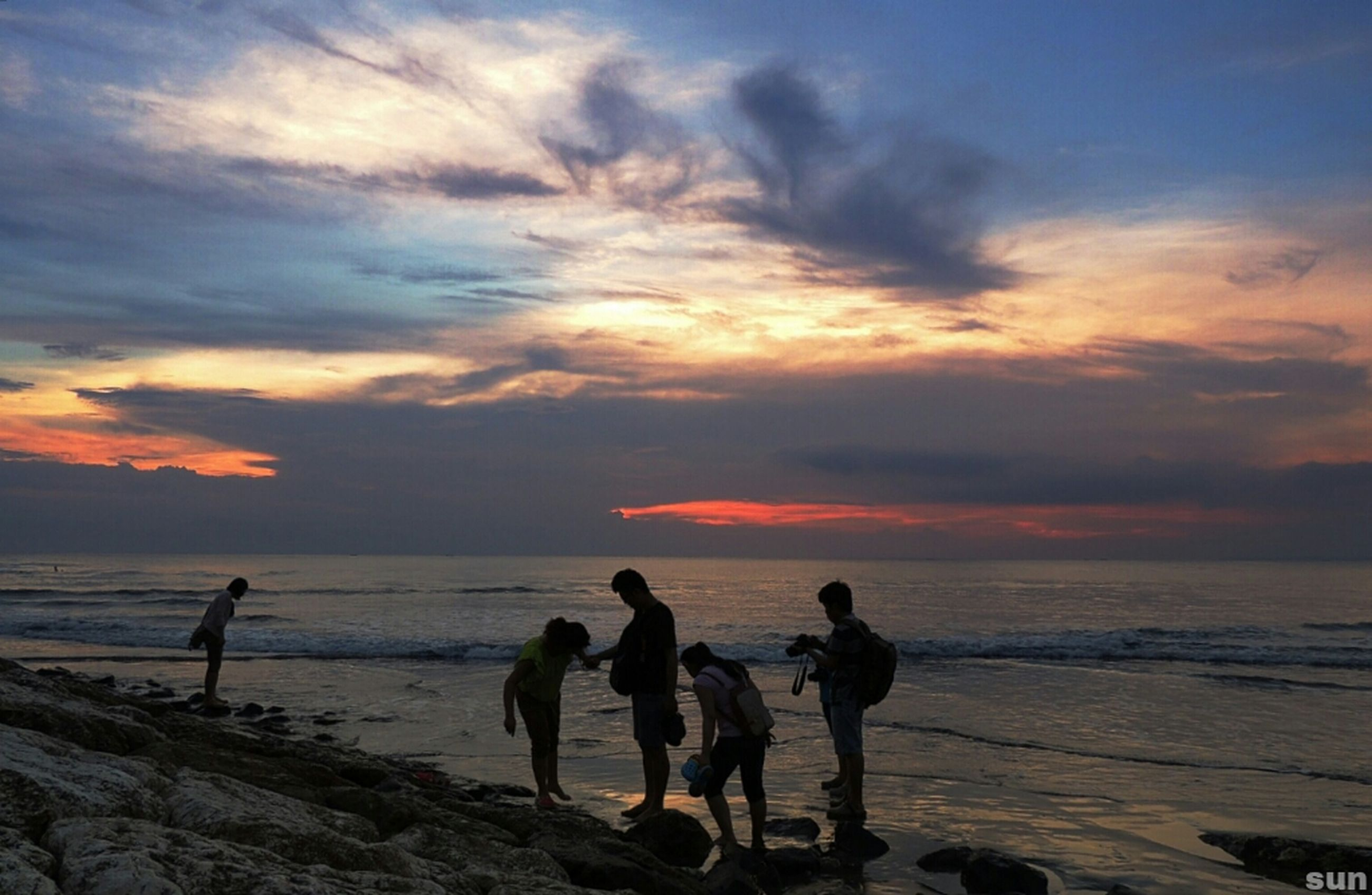 sea, sunset, horizon over water, beach, water, sky, shore, scenics, beauty in nature, silhouette, cloud - sky, tranquil scene, orange color, tranquility, leisure activity, nature, men, idyllic, lifestyles