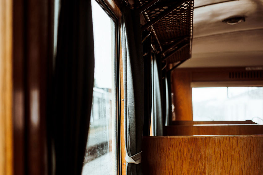 Short Trip Architecture Built Structure Curtain Day Glass - Material Indoors  Mode Of Transport Nature No People Old Train Public Transportation Rail Transportation Seat Sky Train Train - Vehicle Transparent Vehicle Interior Warm Warm Colors Window Wood - Material The Architect - 2018 EyeEm Awards