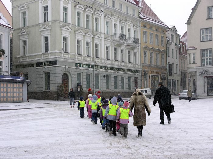 People walking on street in city during winter