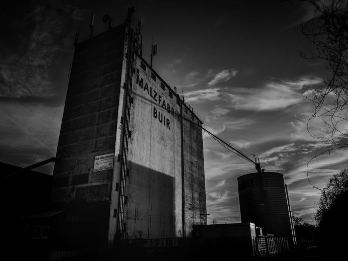 Building Exterior Architecture Sky Built Structure Cloud - Sky Low Angle View Building Nature Industry No People Dusk Outdoors City Factory Day Communication Tall - High Overcast Text Tower Buiräbähnlisafari NRW Malzfabrik