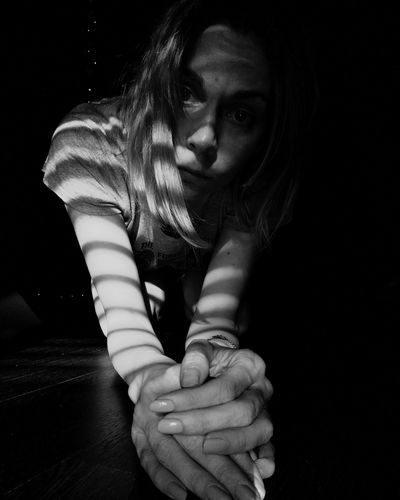 Portrait of woman sitting in darkroom