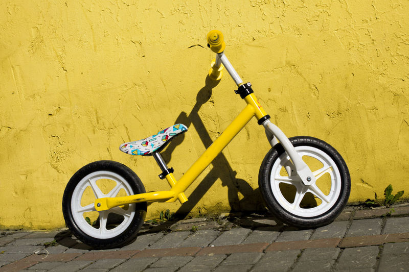 Kids Bike Paint The Town Yellow Bicycle Building Exterior Day Kids Bicycle Mode Of Transport No People Outdoors Stationary Tire Transportation Yellow Yellow Bicycle Yellow Town EyeEmNewHere