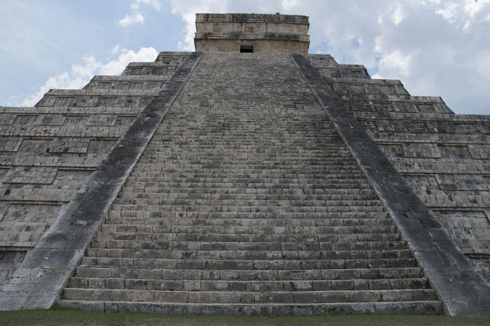 An alternative view at chitzen itza of the stunning temple Ancient Ancient Civilization Archaeology Architecture Building Exterior Built Structure Cloud - Sky Day History Low Angle View No People Old Ruin Outdoors Place Of Worship Pyramid Sky Steps The Past Tourism Travel Travel Destinations