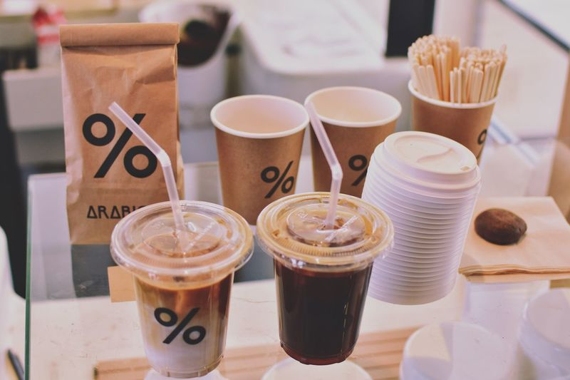 High angle view of disposable cups on table