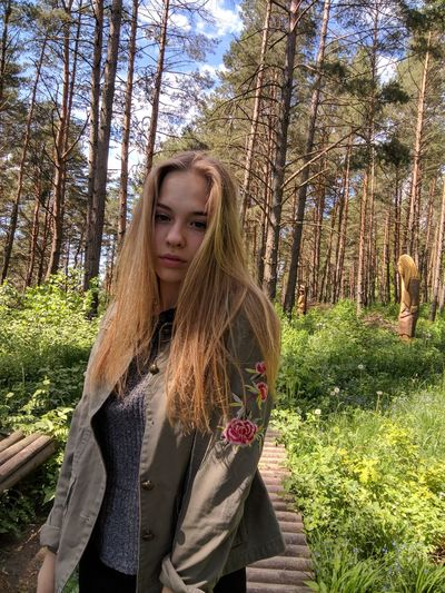 Blond Hair Day Forest Growth Leisure Activity Lifestyles Long Hair Nature One Person Outdoors People Real People Standing Tree Tree Trunk Young Adult Young Women