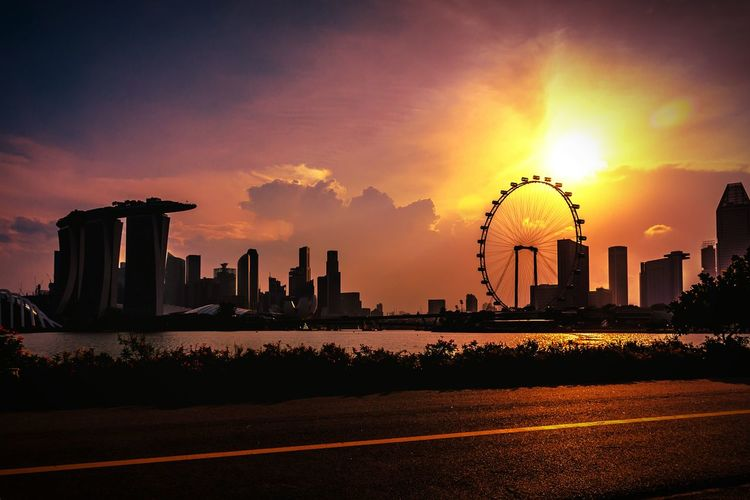 Silhouette Marina Bay Sands Against Sky During Sunset In City