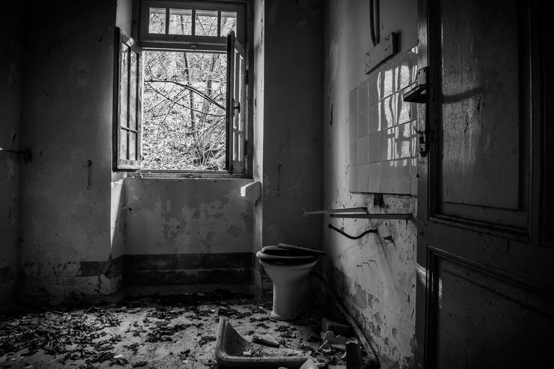 Abandoned Architecture Bad Condition Damaged Day Desolate Destruction Deterioration Dirty Domestic Room Flushing Toilet Indoors  Messy No People Obsolete Old Ruin Rotting Rubble Run-down Toilet Bowl Unhygienic Weathered Window