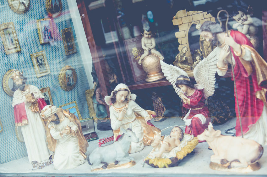 Nativity scene behind window in shop in Porto Portugal Behind Window Buy Celebration Christianism Christmas Cultures Decoration Devotion Feith Figurine  God Greetings Human Representation Indoors  Jesus Joseph Maria Nativity Scene Ornaments Sculpture Sell Shop Statue Three Kings Unusual