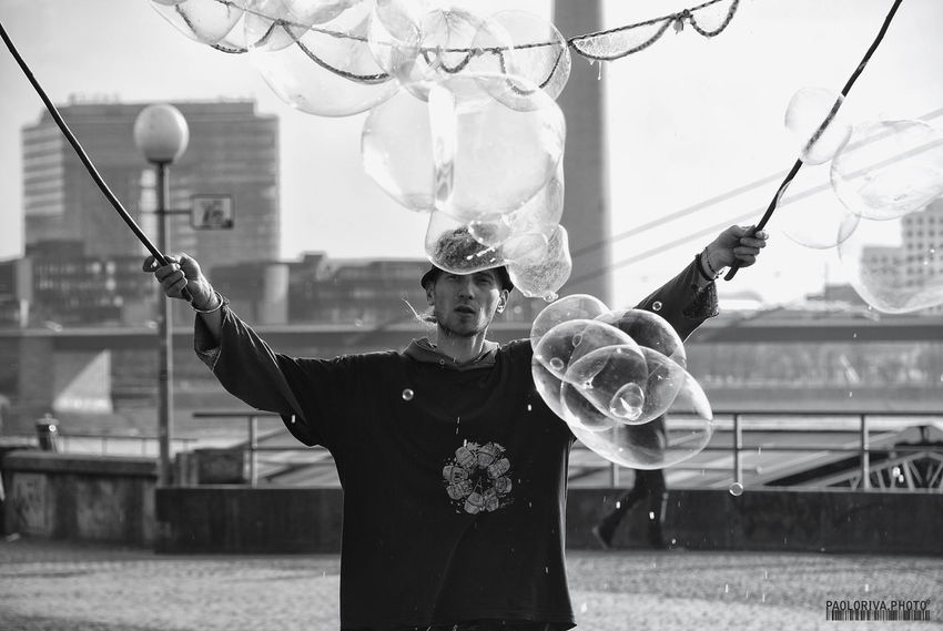 Balloon Black & White Blackandwhite Casual Clothing Day Focus On Foreground In Front Of Large Leisure Activity Lifestyles Monochrome Monochrome Photography Person Streetphotography
