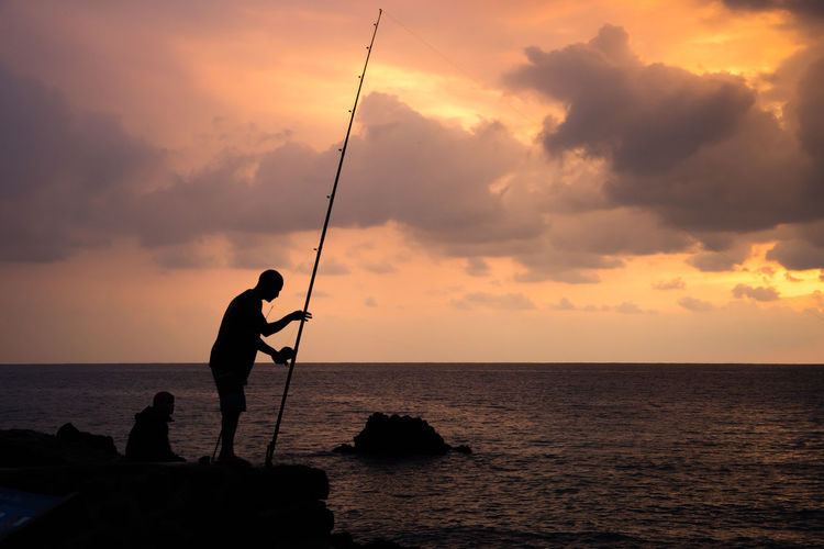 Hawaii Hawaii Life Beauty In Nature Cloud - Sky Fishing Fishing Pole Horizon Over Water Men Nature One Person Outdoors Real People Scenics Sea Silhouette Sky Standing Sunset Water Big Island Fisherman