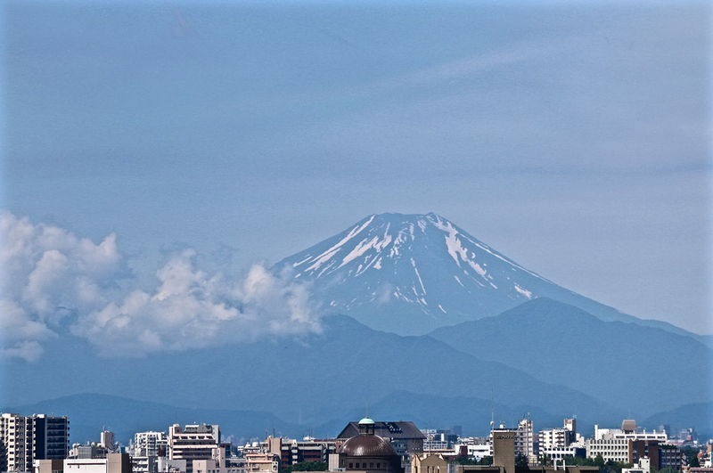 Scenic View Of Cityscape Against Mount Fuji