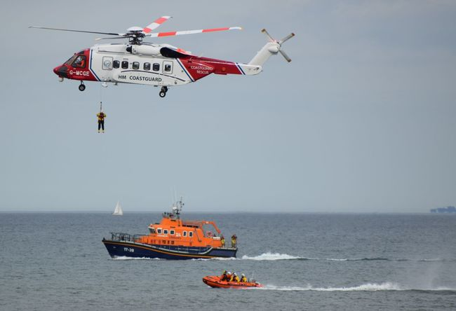 RNLI Open Day, August 2017. Withernsea lifeboat, Humber Lifeboat, RNLI Coastguard Rescue Helicopter Lifeboat RNLI Air Vehicle Airplane Boat Clear Sky Coastguard Cockpit Day Flying Helicopter Horizon Over Water Lifeboat RNLI Mid-air Mode Of Transport Nature Nautical Vessel No People Outdoors Red Rescue Sea Sky Transportation Water Winchman