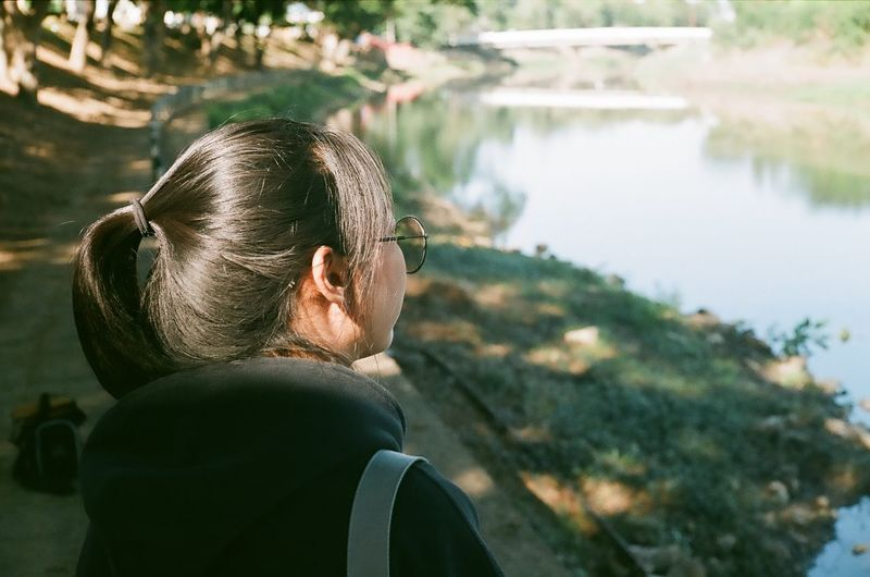 Young woman looking at river