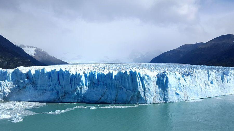 Scenic View Of Perito Moreno Glacier Against Cloudy Sky