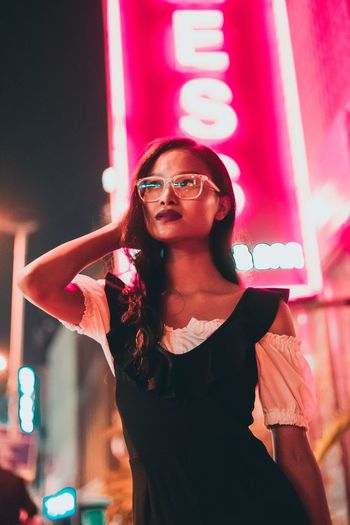 Lights are running out and the colour still fades away Neon Lights Nightphotography Portrait Of A Woman Glasses One Person Young Adult Sunglasses Front View Women Portrait Arts Culture And Entertainment Young Women Hairstyle Real People Casual Clothing First Eyeem Photo