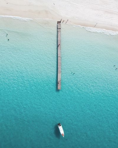 Pier and speedboat in sea