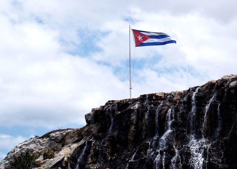 Flag Patriotism Sky Wind Low Angle View Cloud - Sky Pride Nature Rock - Object Day Outdoors Mountain No People Cliff Beauty In Nature From Where I Stand Havanna, Cuba Cuba Havana Malecon Cuban Flag