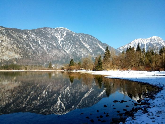 Hallstätter See in the beautiful country of Austria. A dream destination in the Austrian alps near Hallstatt. Reflection Mountain Range Austria Alps Alps Austria Snow Winter Lake Clear Sky Cold Temperature Forest Reflection Lake Wilderness Alpine Glacial Wilderness Area