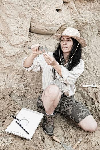 Paleontologist holding tool