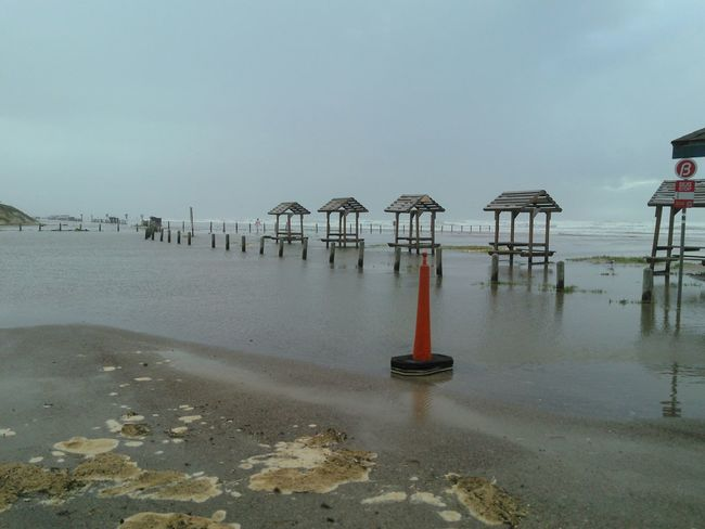 Tropical Storm Flooded Beach and Road