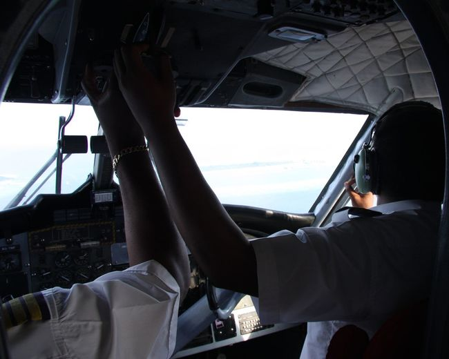 Rear View Of Pilots In Airplane