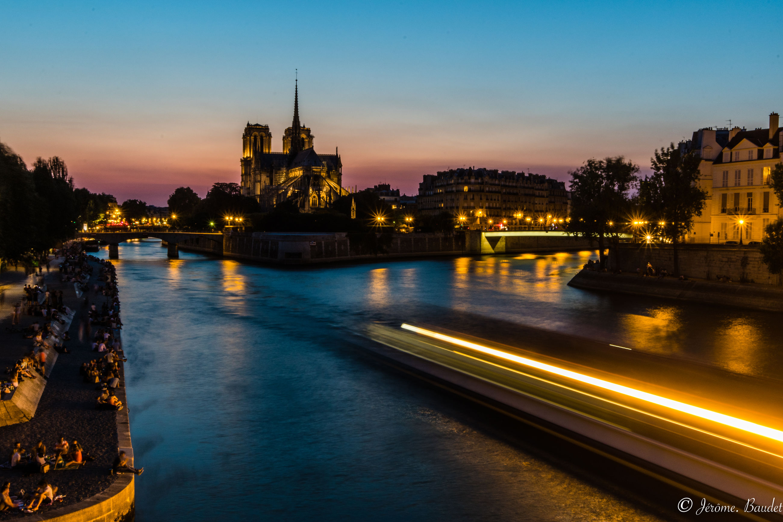 illuminated, architecture, built structure, water, building exterior, sky, river, transportation, long exposure, travel destinations, sunset, nature, night, city, bridge, reflection, motion, light trail, connection, no people, bridge - man made structure, outdoors