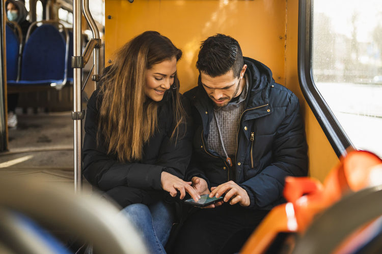 Young women sitting in train