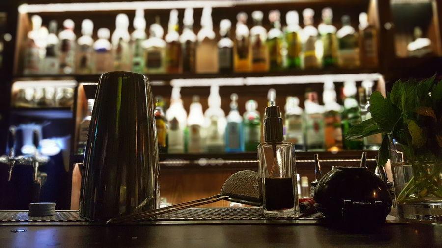 Glass of bottles on table in restaurant